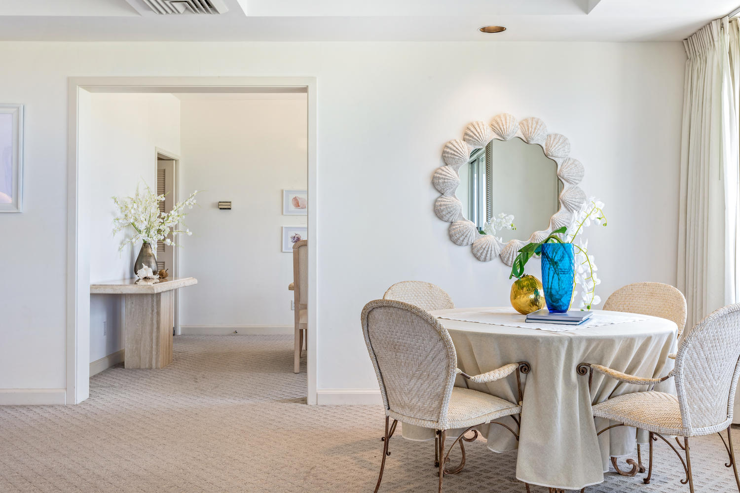 Florals and on-trend, simple accessories bring color and interest to rooms | Penthouse unit within Waikoloa Resort, Big Island of Hawaii.