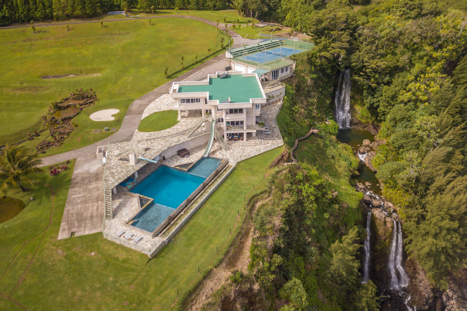 The many resort-like amenities and waterfalls on this unique cliff-side estate add value and support a higher asking price. ( MLS # 613831 )