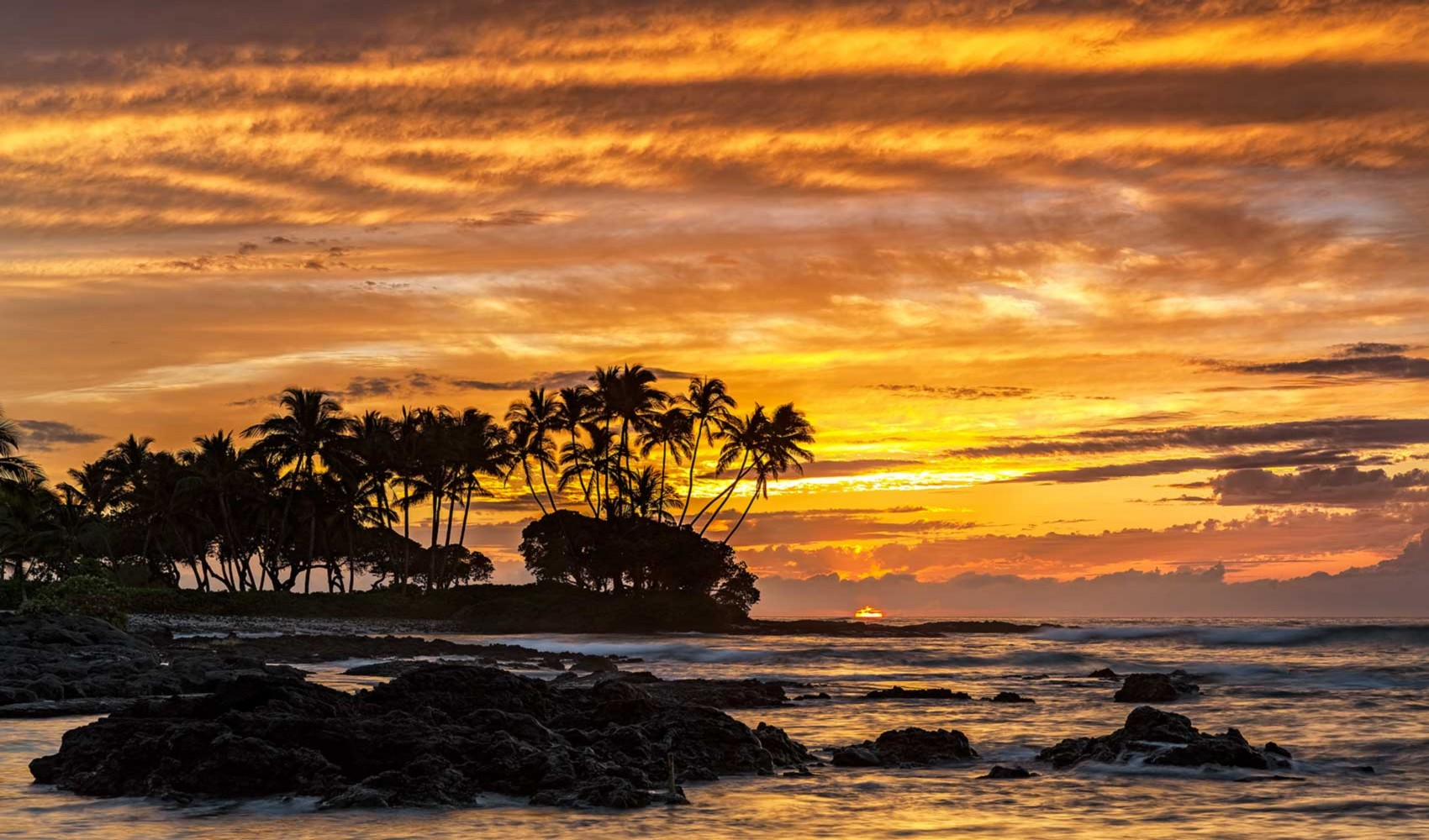 """View from the oceanfront community of Pauoa Beach at Mauna Lani Resort in the heart of the Kohala Coast aka """"Gold Coast"""" because of its many toney luxury resorts and homes."""