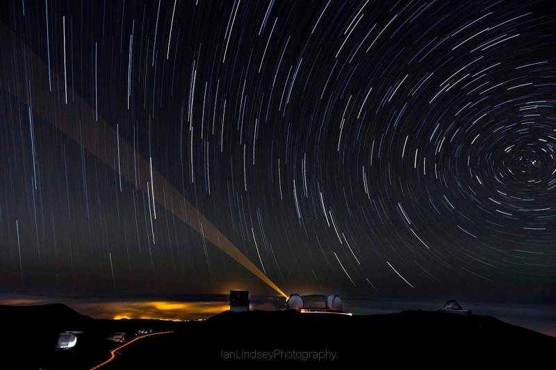 The Mauna Kea summit is the highest point in Hawai'i where you and your partner can catch a sunset and gaze at the stars surrounded by clouds in a moon-like landscape. Photo courtesy of: Ian Lindsey Photography