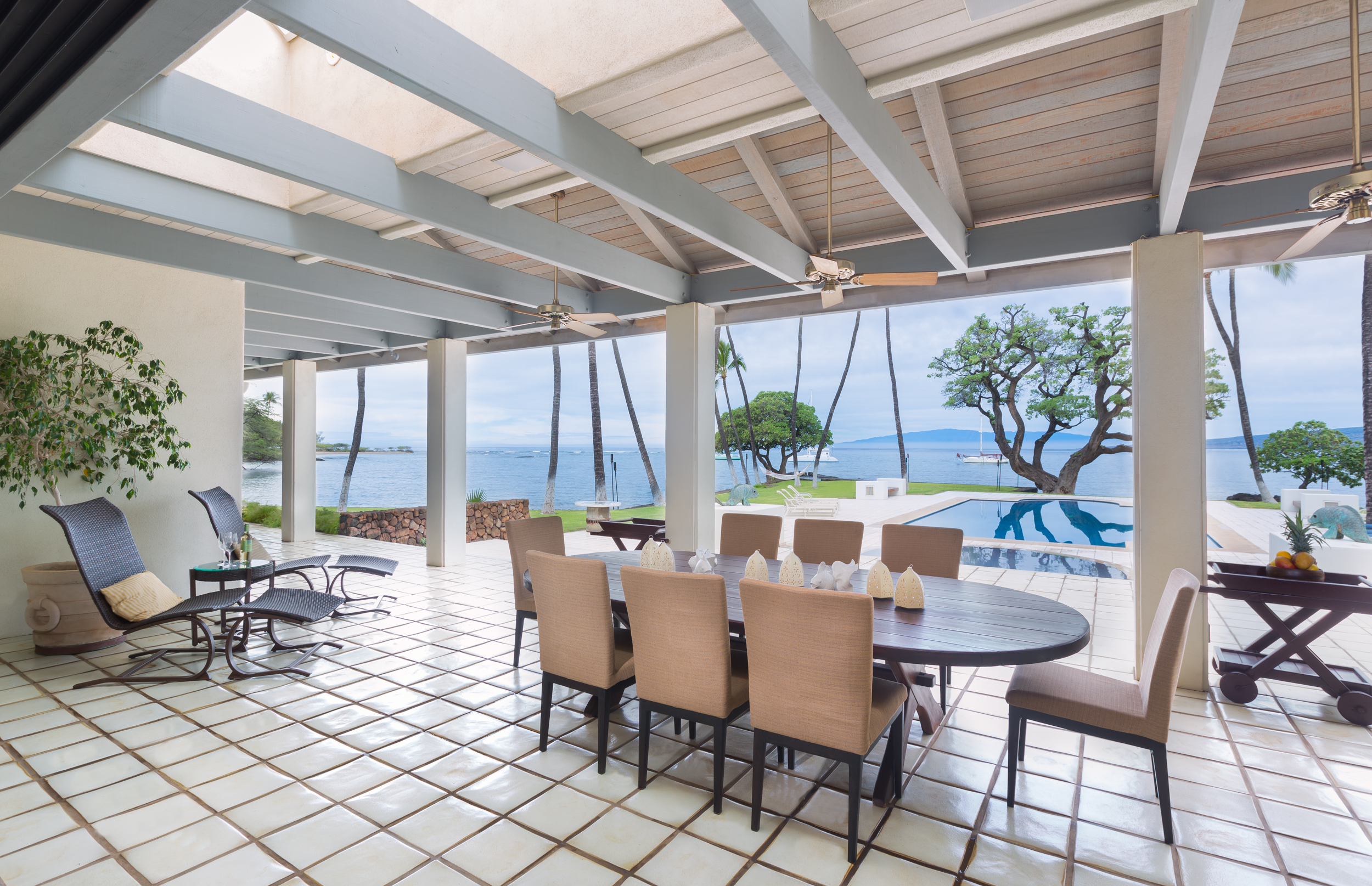 Covered outdoor lanais provide the best of outdoor living and entertaining at this  oceanfront home.