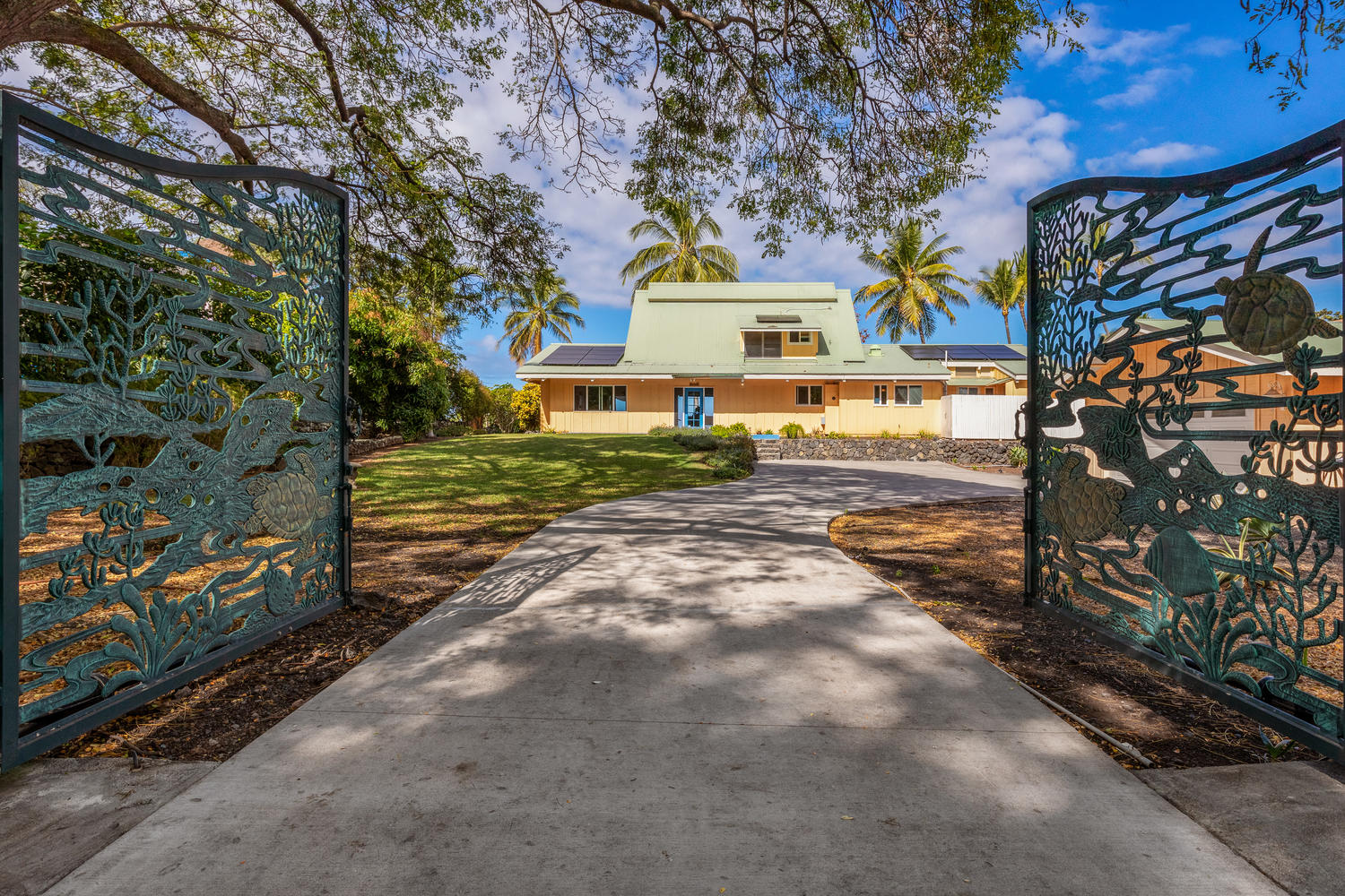 Artistic custom gates open to this  home  set directly on scenic – and historic – Kealakekua Bay in South Kona.