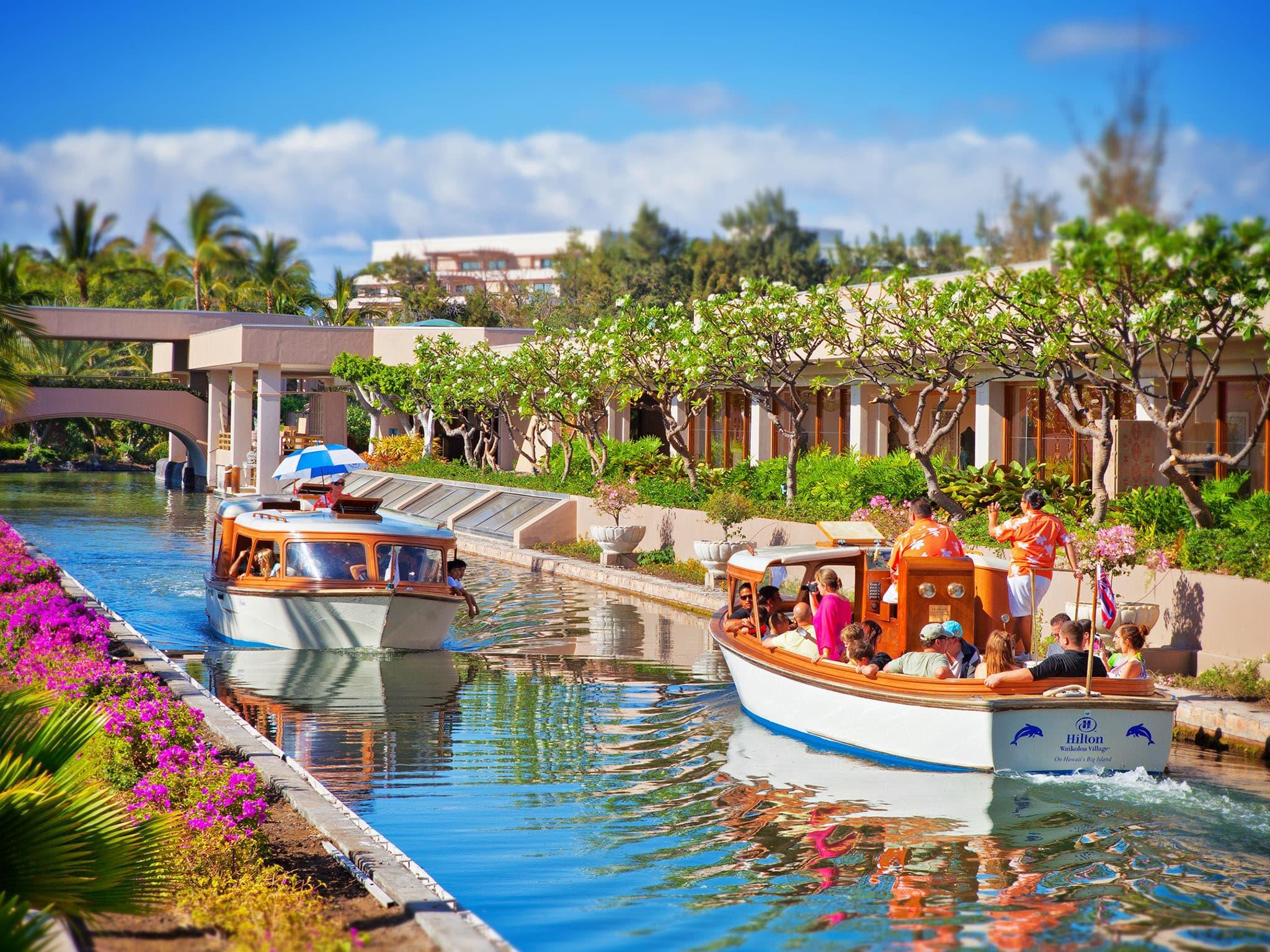 Canal boats at Hilton Waikoloa transport guests around the property. Photo courtesy Hilton Waikoloa Village.
