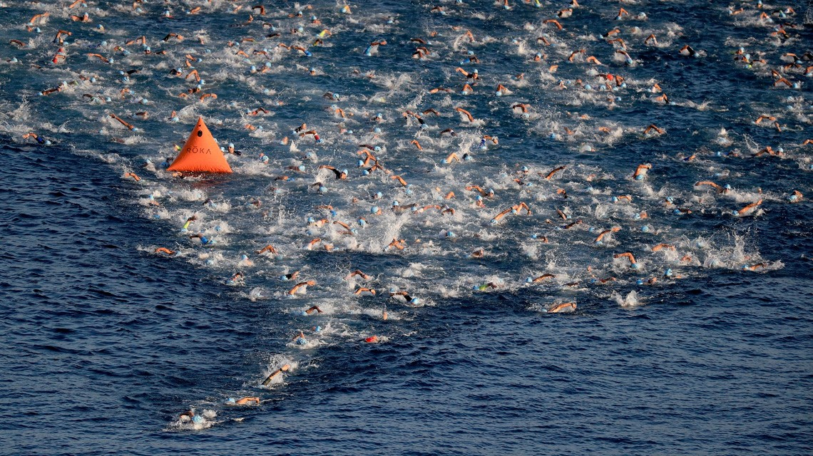 Athletes round the ½ way buoy on the Ironman World Championship course in Kailua-Kona Bay. Photo by Sean M. Haffey/Getty Images for IRONMAN.