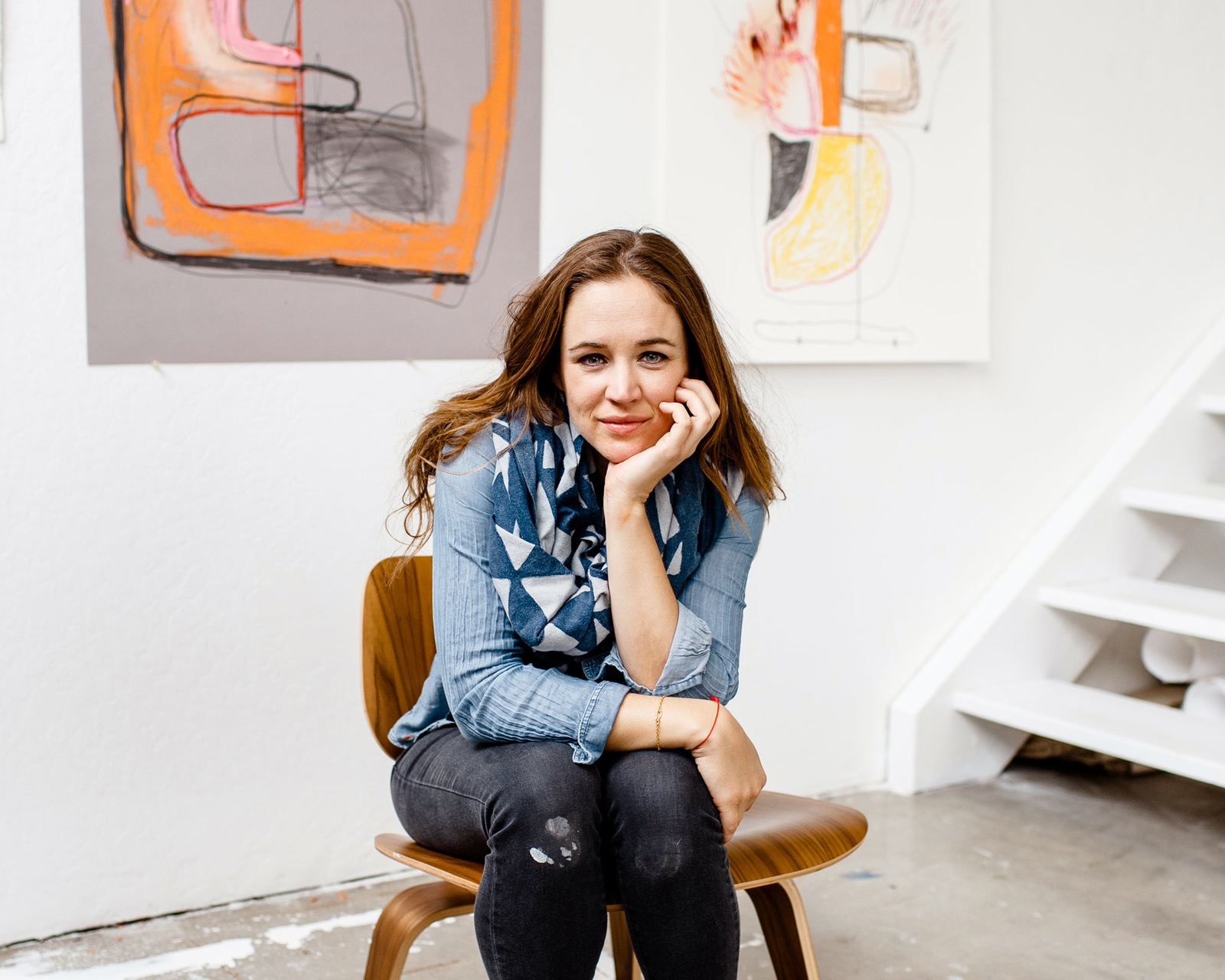 Elle Luna works in her studio, where she paints, draws, and experiments