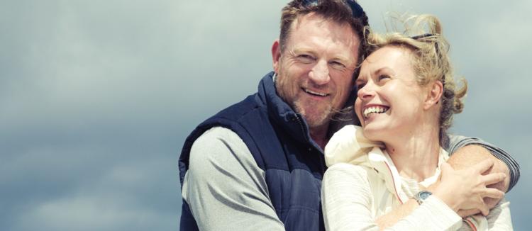 older-couple-with-dental-onlays-hug-outside.jpg