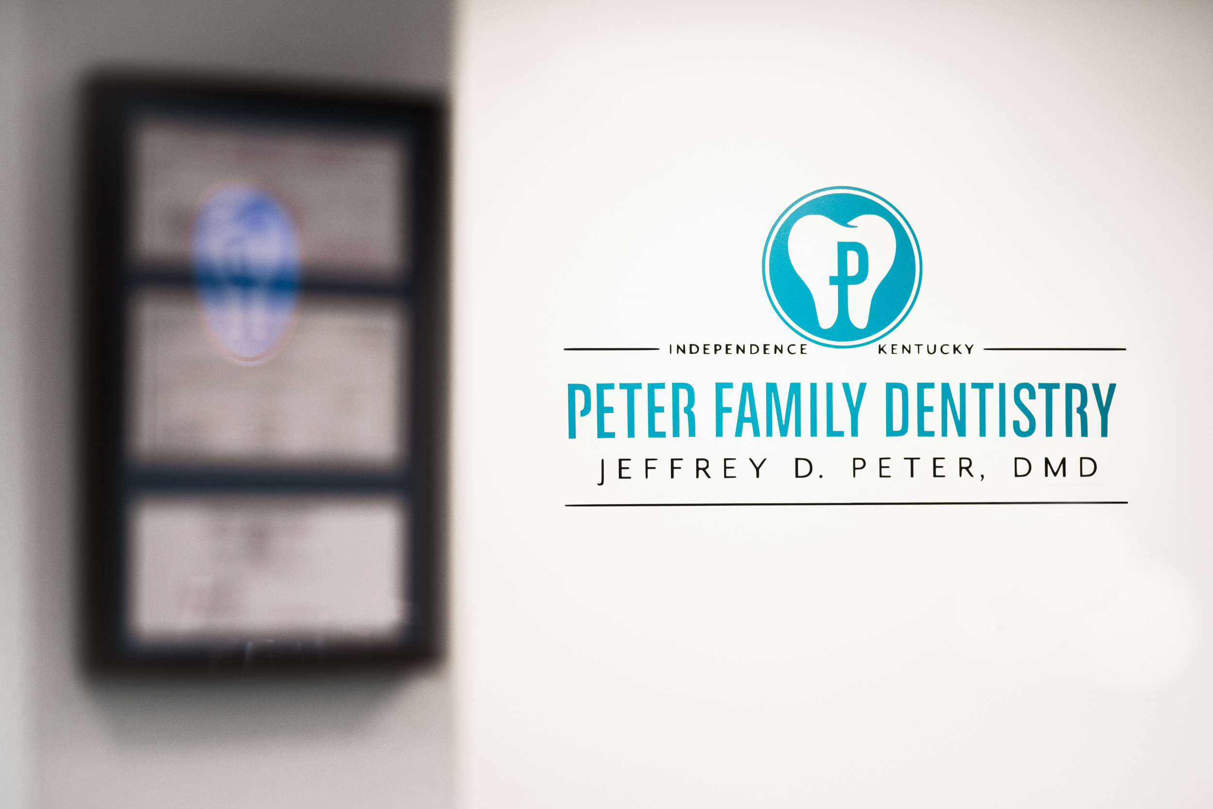 Peter Family Dentistry Logo On Wall