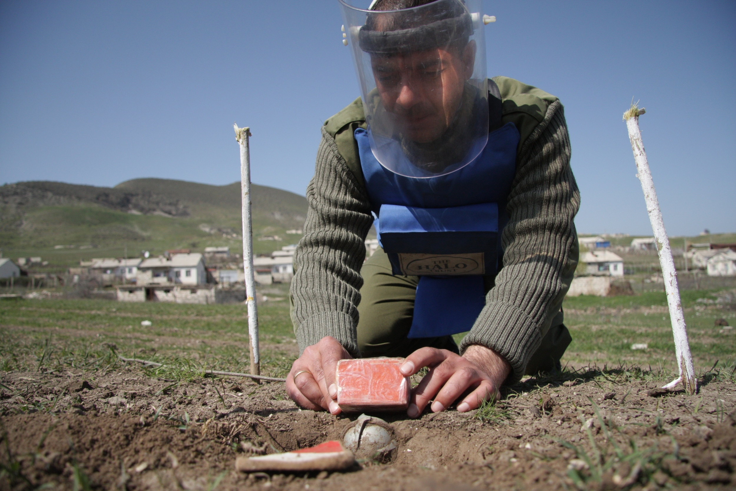 A shOAB cluster munition found near Vazgenashan village - the deminer places an explosive charge to destroy it.jpg