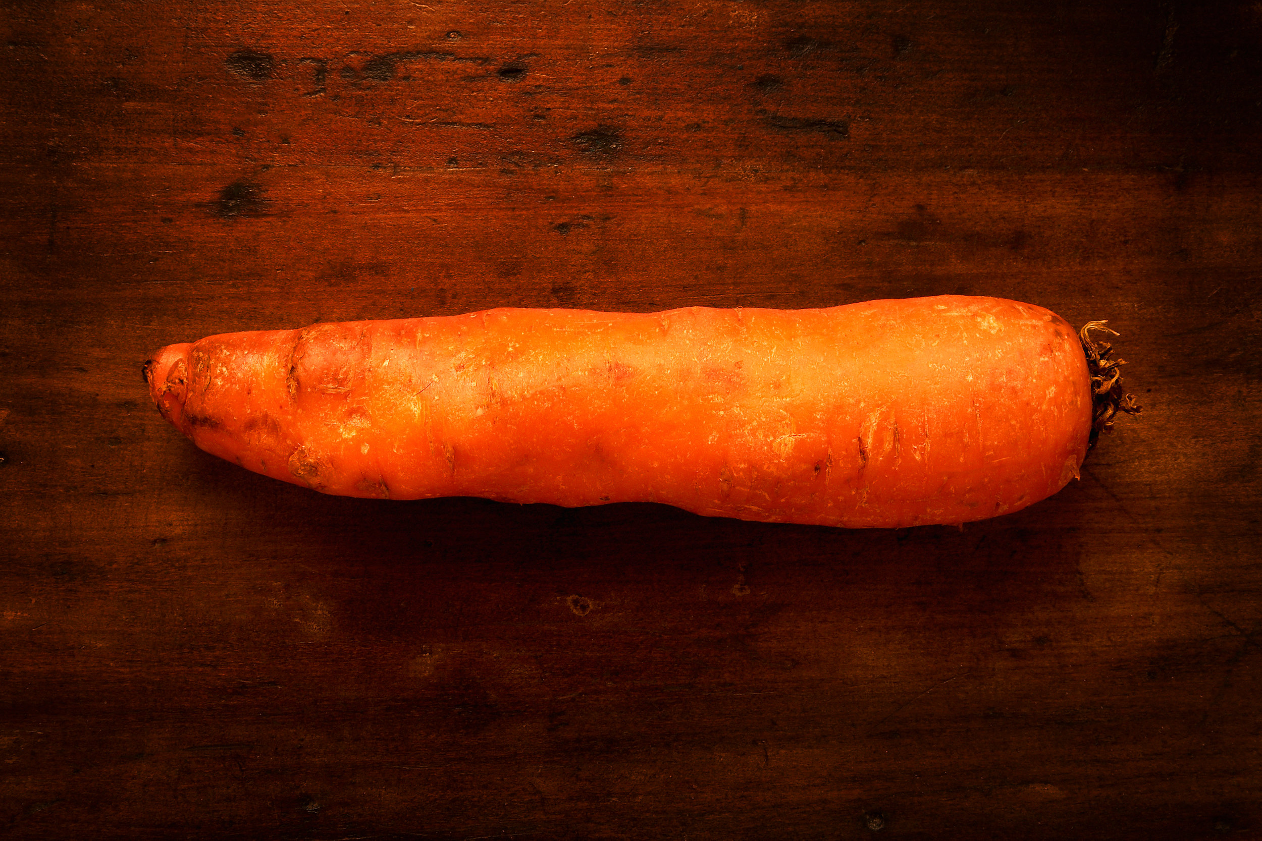 CARROT-ORANGE-ROOT-VEGETABLE-ON-WOOD-ORGANIC.jpg