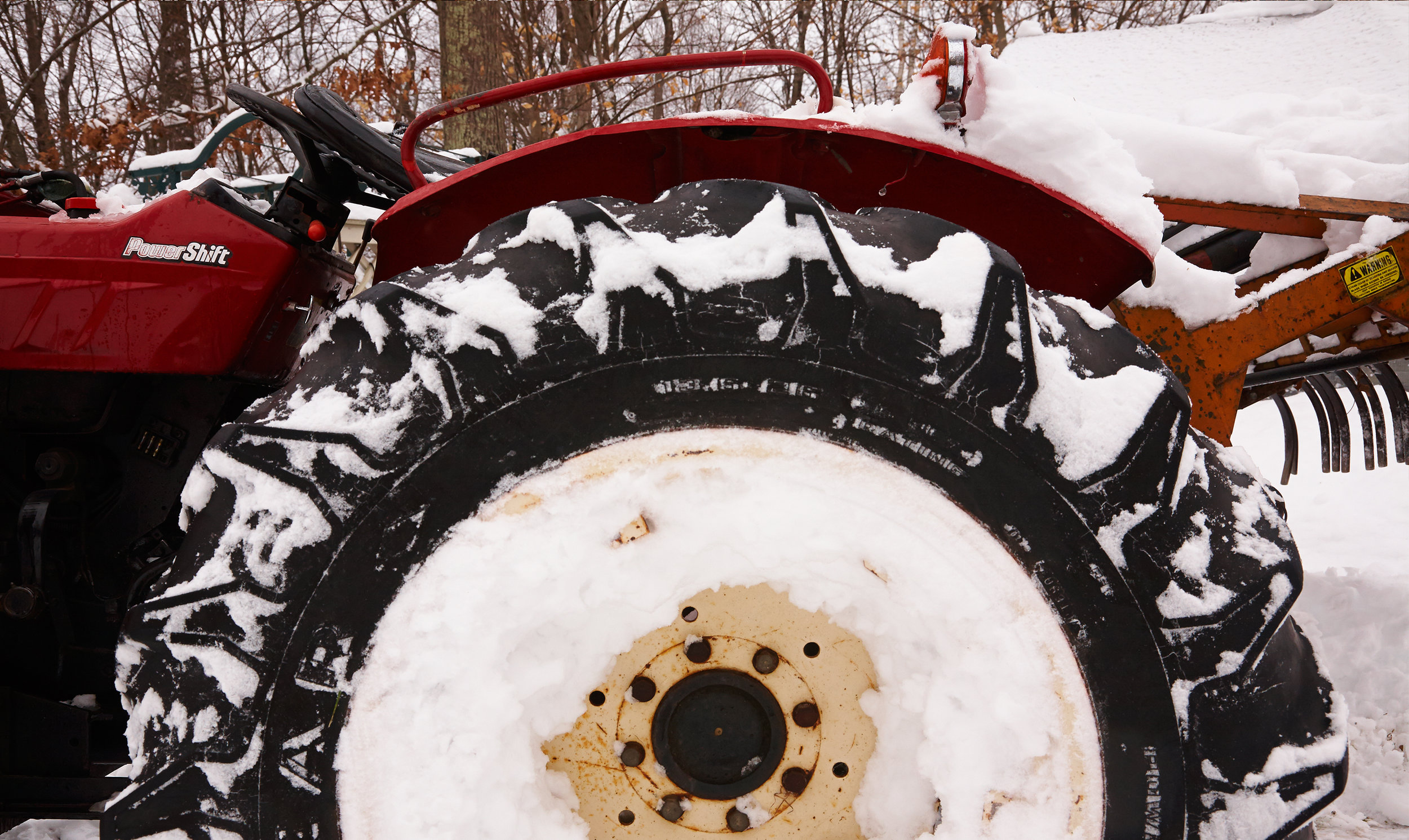 TRACTOR-WHEEL-IN-SNOW-AT-WILTSHIRE-FARM-©-JONATHAN-R.-BECKERMAN-PHOTOGRAPHY.jpg