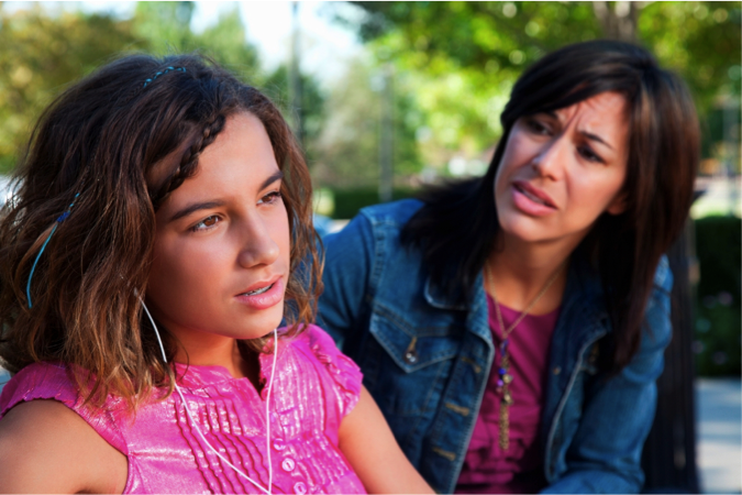teen headphones and mom.png