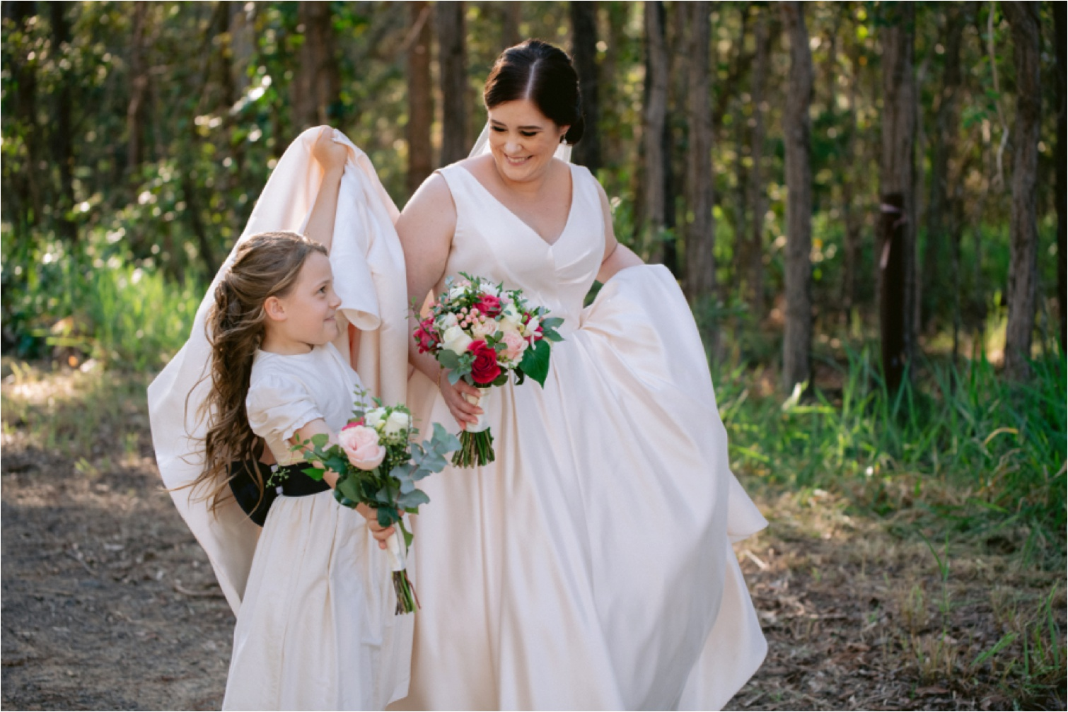 Flower_girl_helping_with_dress_photo