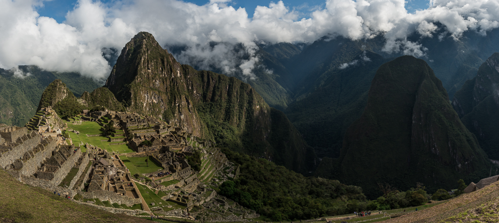 Machu Picchu - View of the Urban Section in the foreground, with Hayna Picchu in the background. The photograph is taken from the Agricultural Terraces, near the visitor's entrance. The sun had just finished lighting up the Citadel, leaving the surrounding valley and mountains in the shadows.