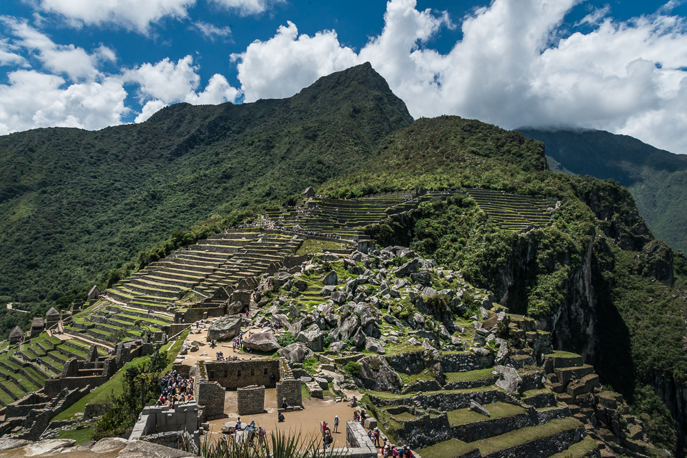Machu Picchu, seen from the higher level of the Sacred Plaza, near the Intihuana stone. In the foreground, we see the Main Temple, below, and the upper section of the Urban Sector. To the left, we see the terraces of the Agricultural Sector, and in the center, in the distance, we see the Watchman's Hut, from where I had taken panoramic views earlier in the morning.