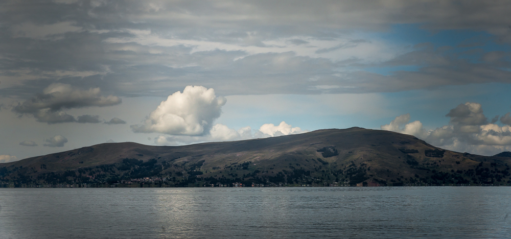 As we head over to Taquile Island, it is as if the sky and the lake are doing their best to show off for us.