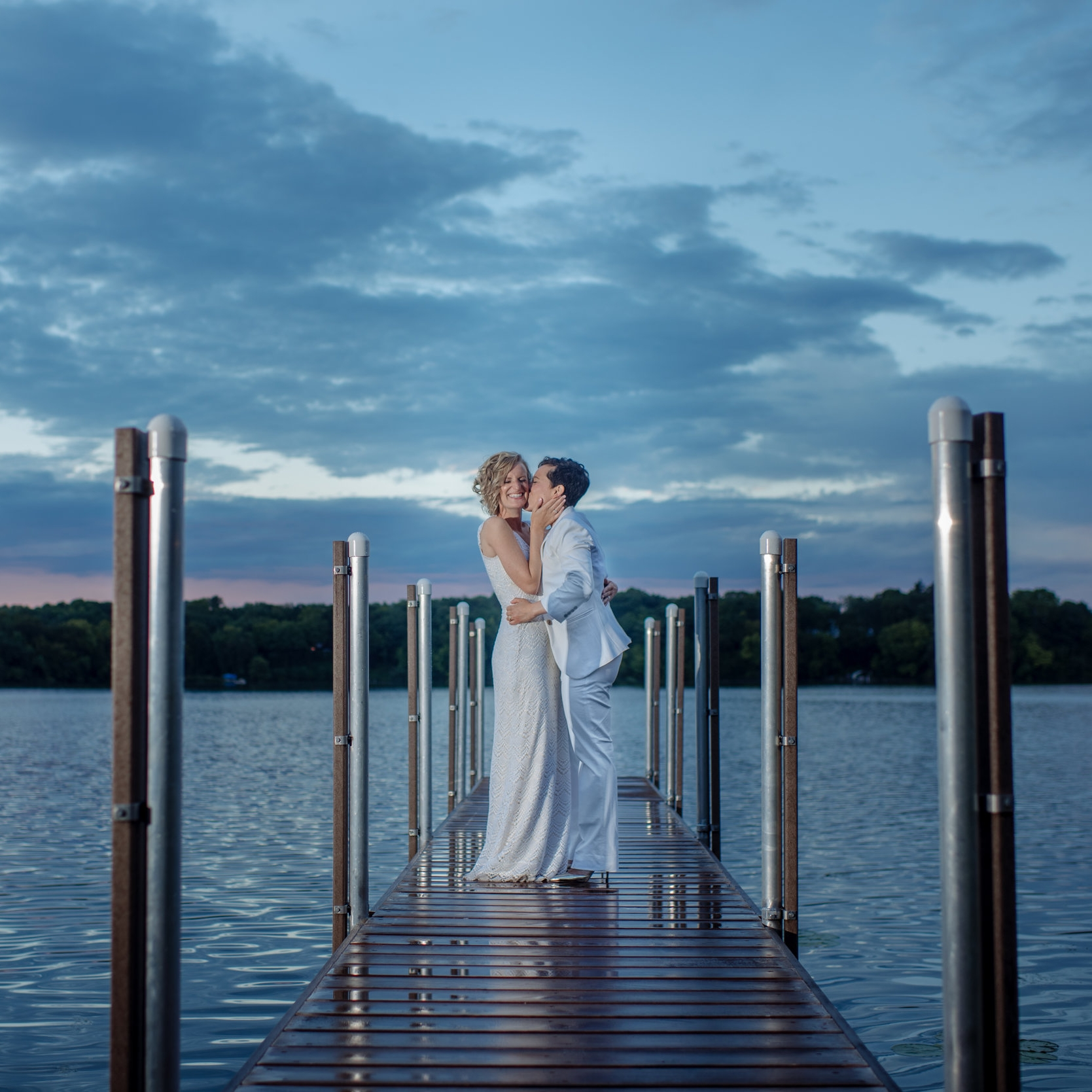 intimate lakeside wedding ceremony for same-sex couple by sincerely pete events