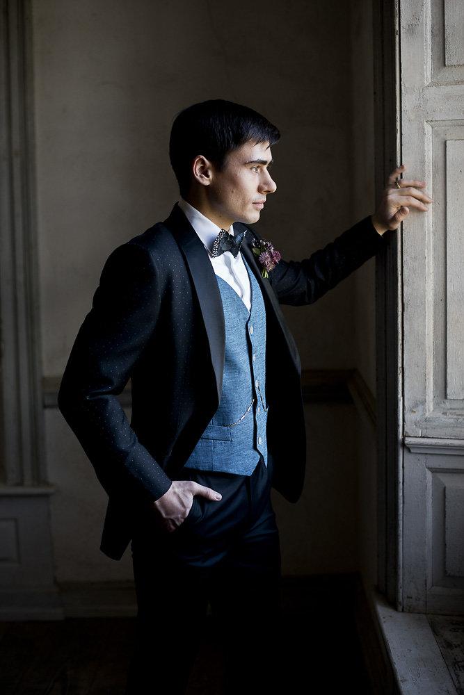 groom anticipating wedding in custom suit wedding photography virginia