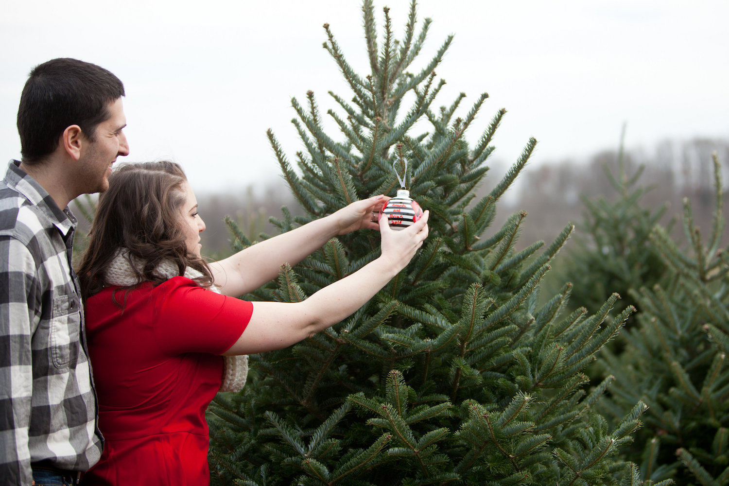 Holiday Ornament Christmas Tree Farm Engagement Shoot Sincerely Pete Events Liz and Ryan Photography