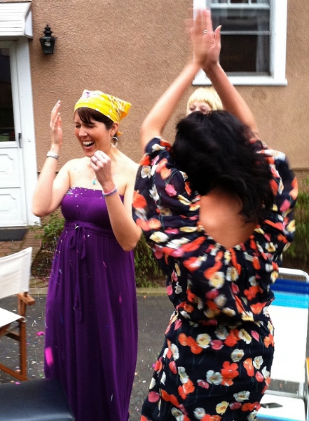 I had no idea I was pregnant during this Easter BBQ that me and my husband threw with some friends. That's me getting hit with a confetti egg. I'm wearing purple and gold because the Lakers were in the playoffs during this time.