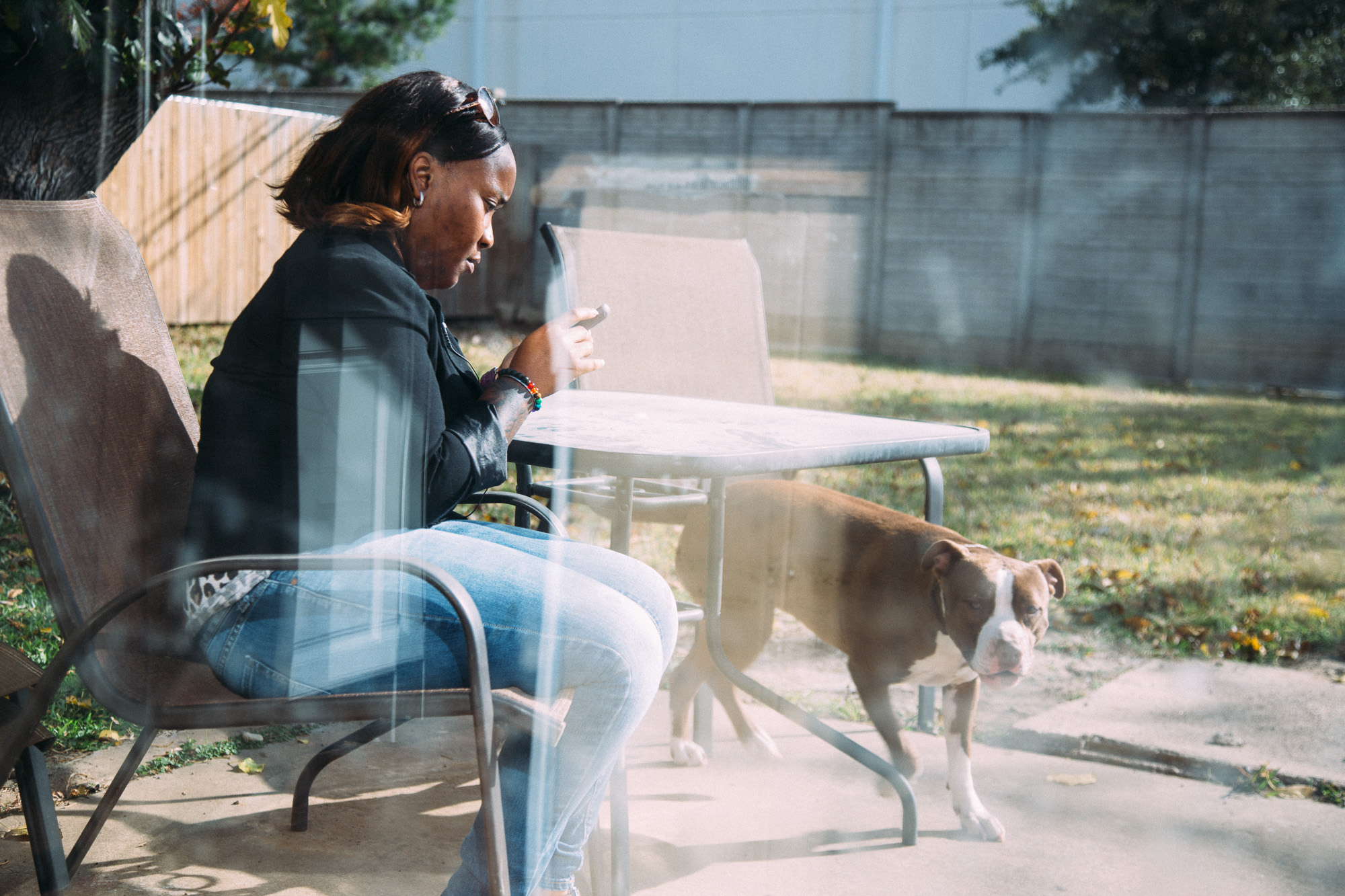 Katrina sits outside with her two pitballs.