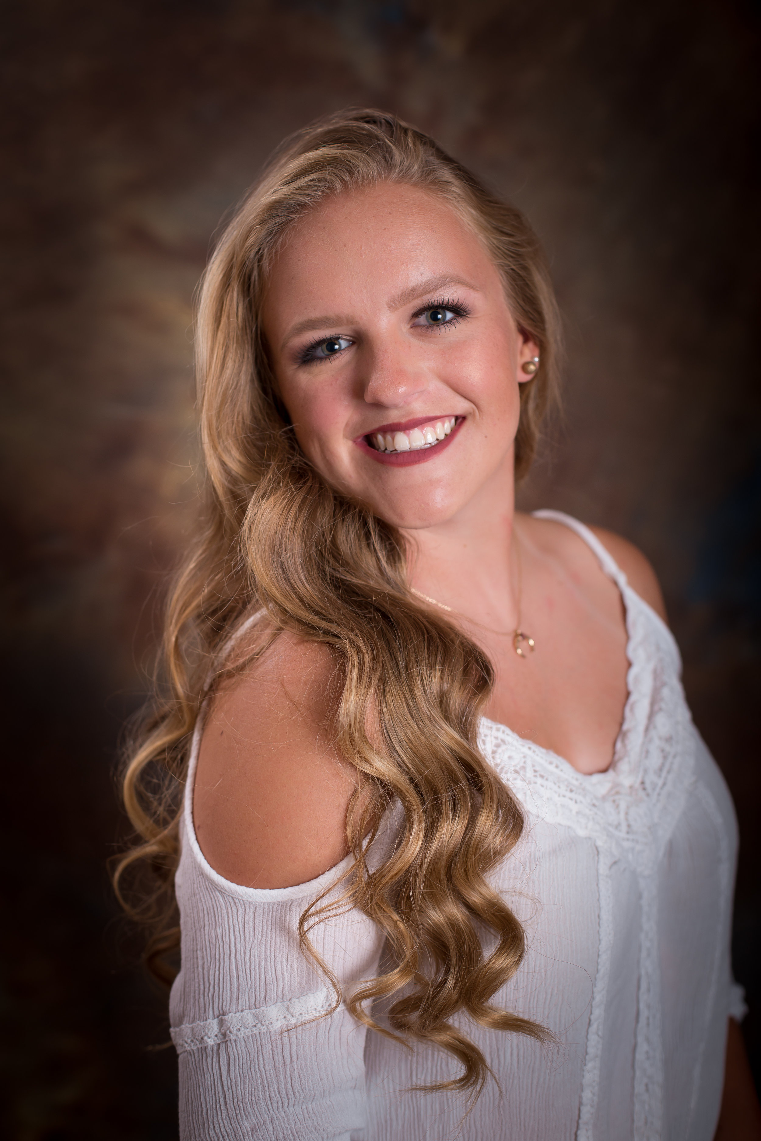High School Senior Portrait Sessions - Senior Portrait Session: $275.00 plus tax, multiple outfit changes, $50.00 print credit and 10% discount on prints.These session generally last around 1 hour.