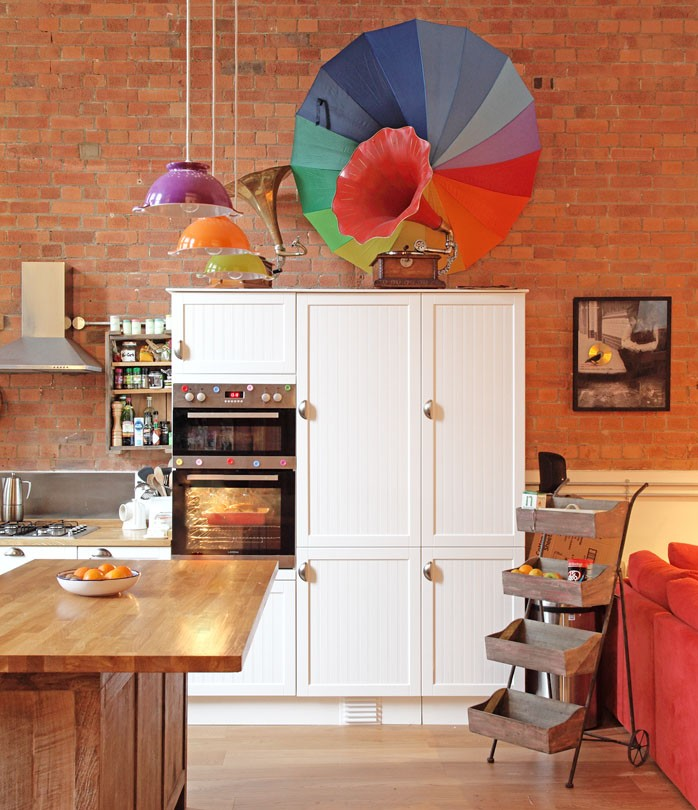 Loft style apartment London; open-plan kitchen; colourful kitchen