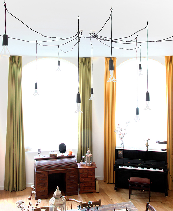 Plumen low energy bulbs form feature lighting in Stoke Newington apartment by Avocado Sweets