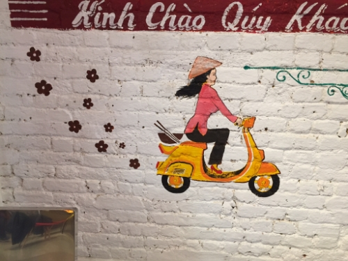 wall mural; vietnamese wall art; exposed brick;