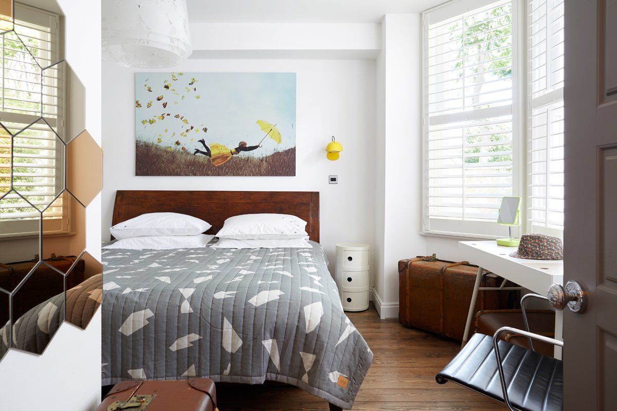 A simpler mix of colours makes the bedroom a restful spot.