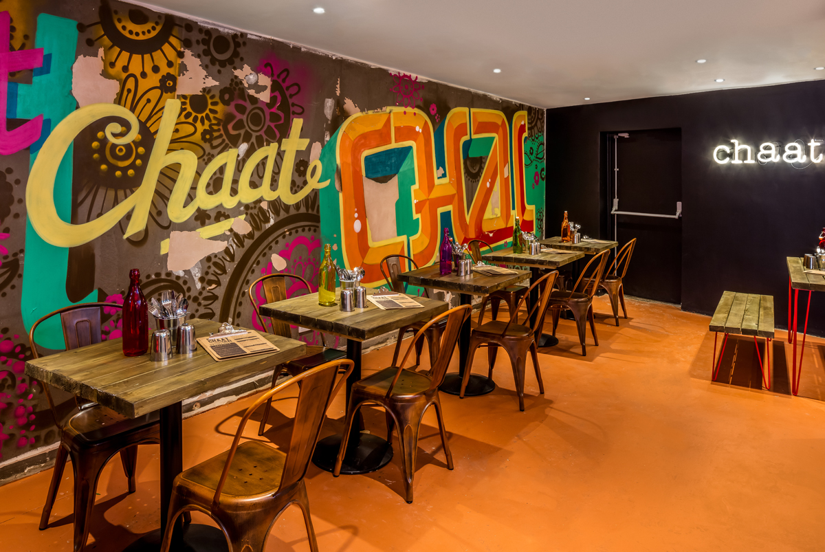 Graffiti art murals by Printshop Studios add to the street-scene vibe in the intimate back bar area.