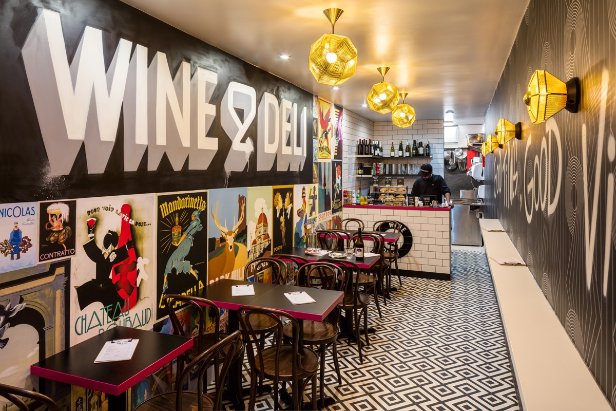 The mash up of art deco and urban street art creates a fresh, unique look for Wine & Deli's debut site