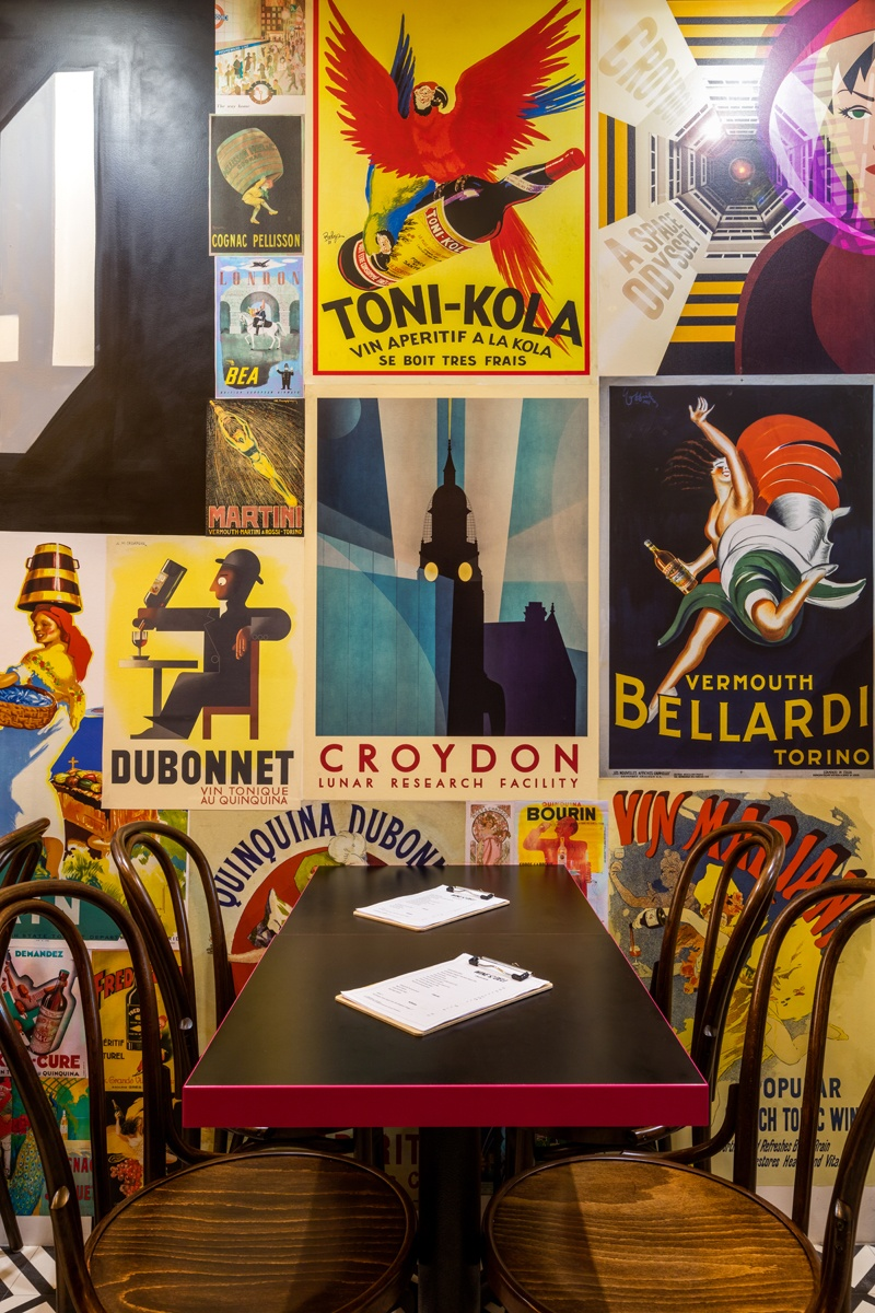 Layered vintage posters encapsulate the art deco meets urban street style - a core part of the brand's DNA