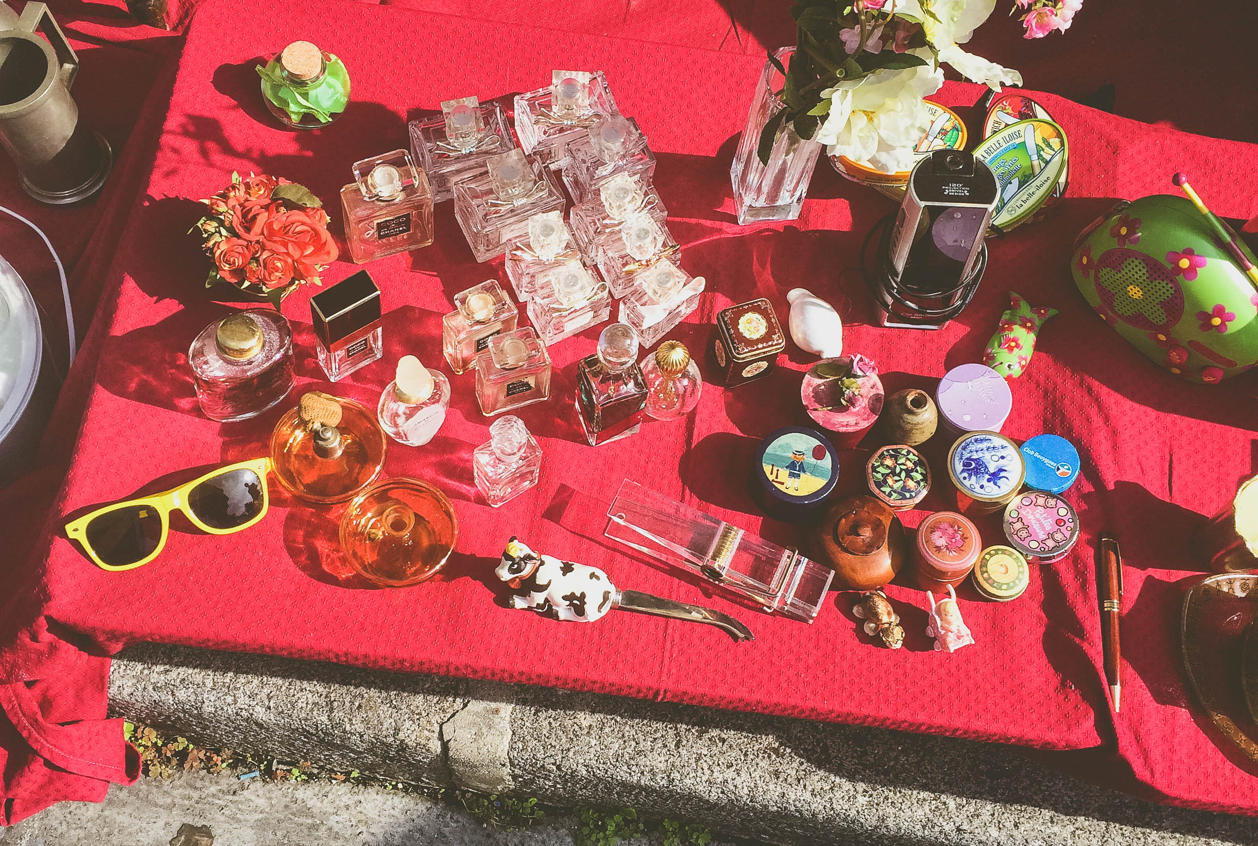 Parisian yard sale: old perfume bottles and pill boxes.