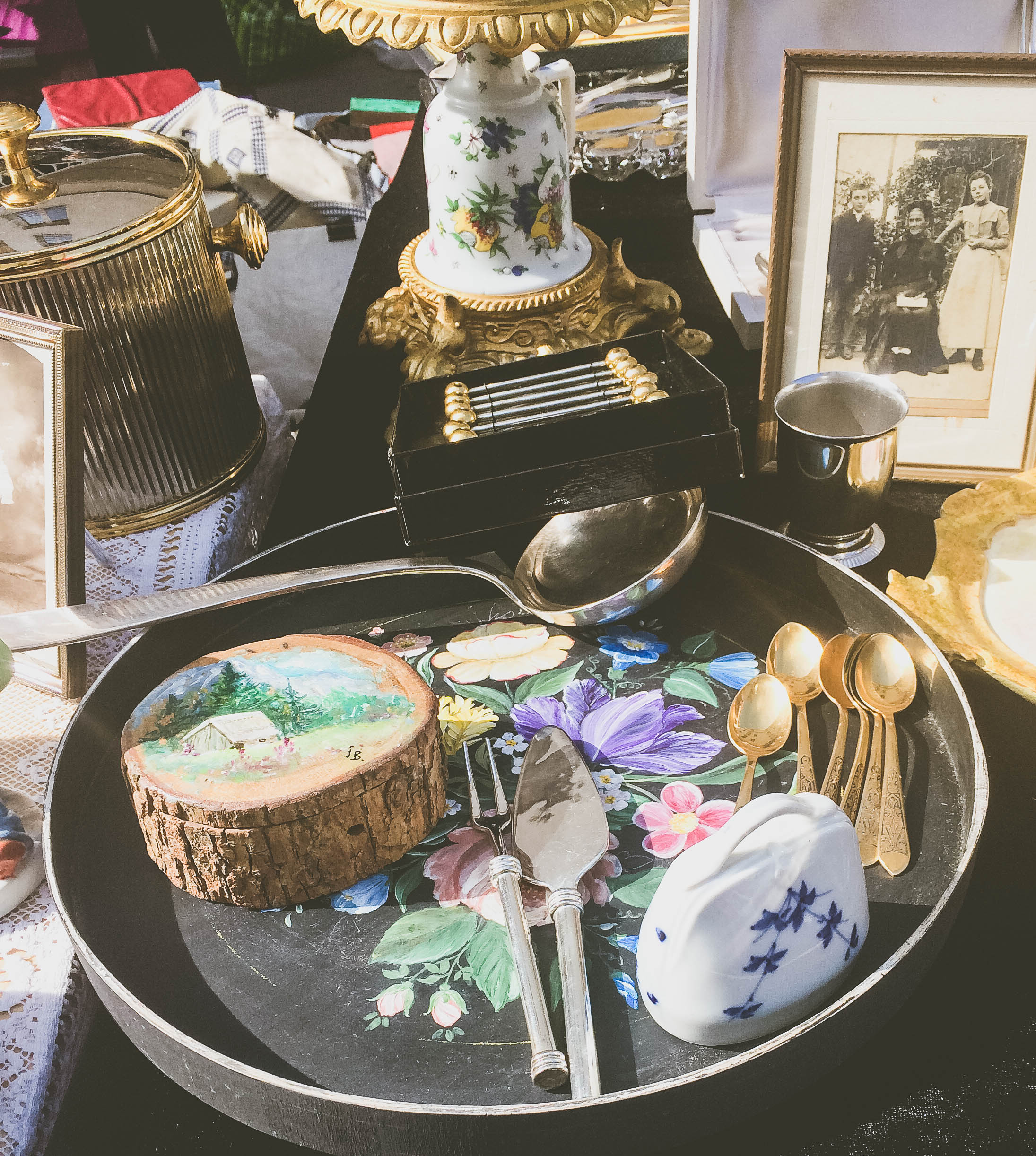 More knick-knacks and household goods, especially spoons, found at a Parisian yard sale
