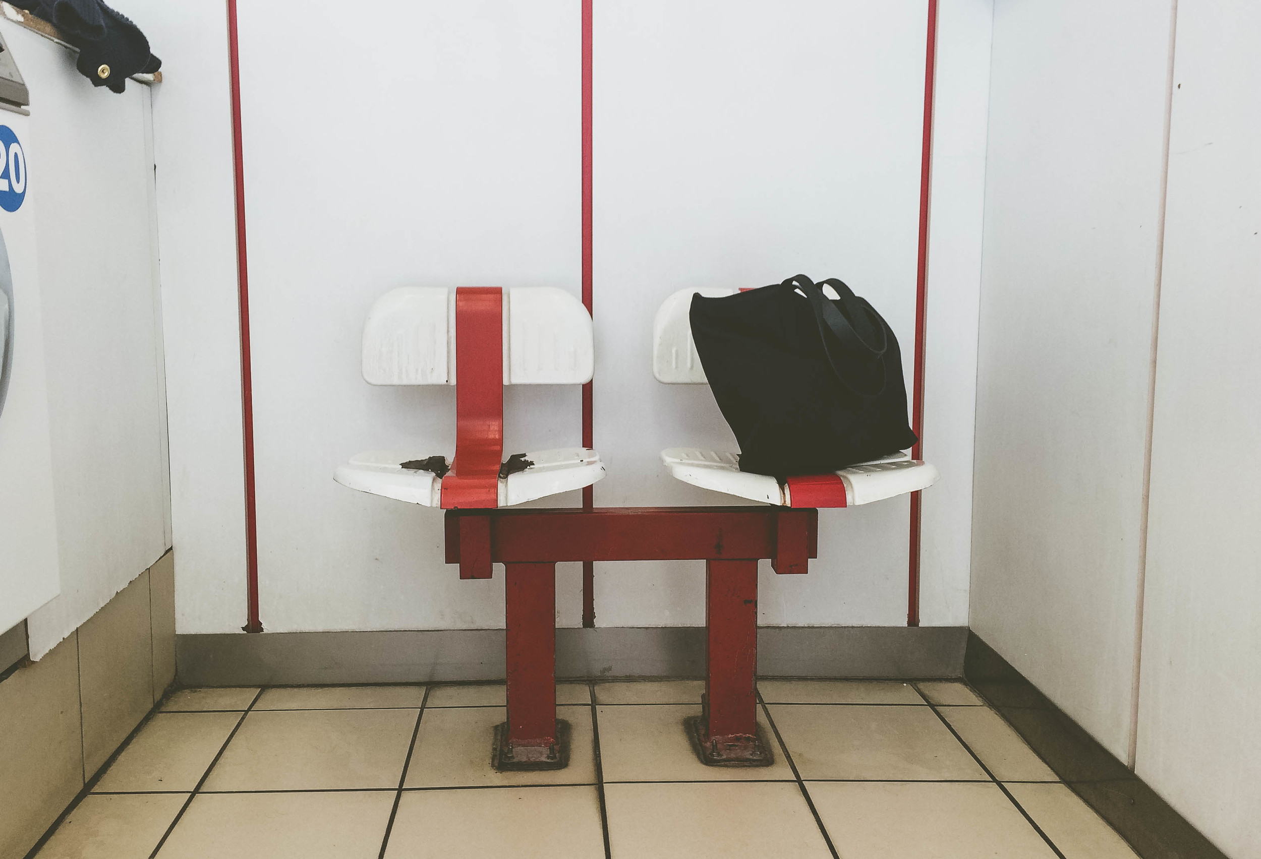 Waiting for laundry to finish at a  laverie  in Paris.