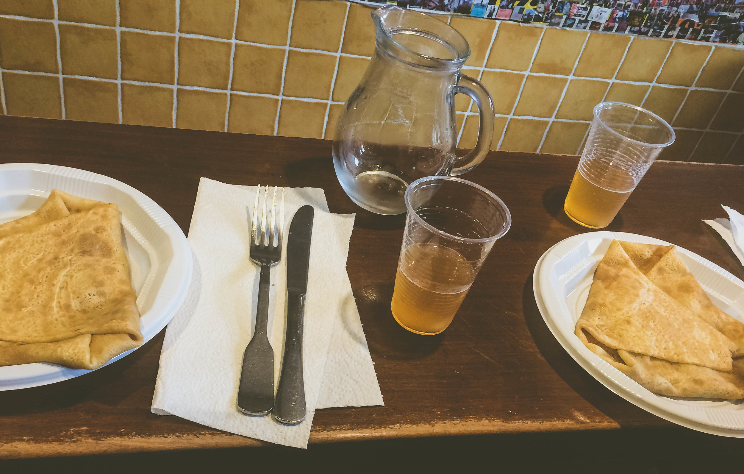 A crepe lunch for 5 euros per person: you get a savory crepe (ham & cheese), a sweet crepe (butter, sugar and cinnamon) and a pichet of cider to share.