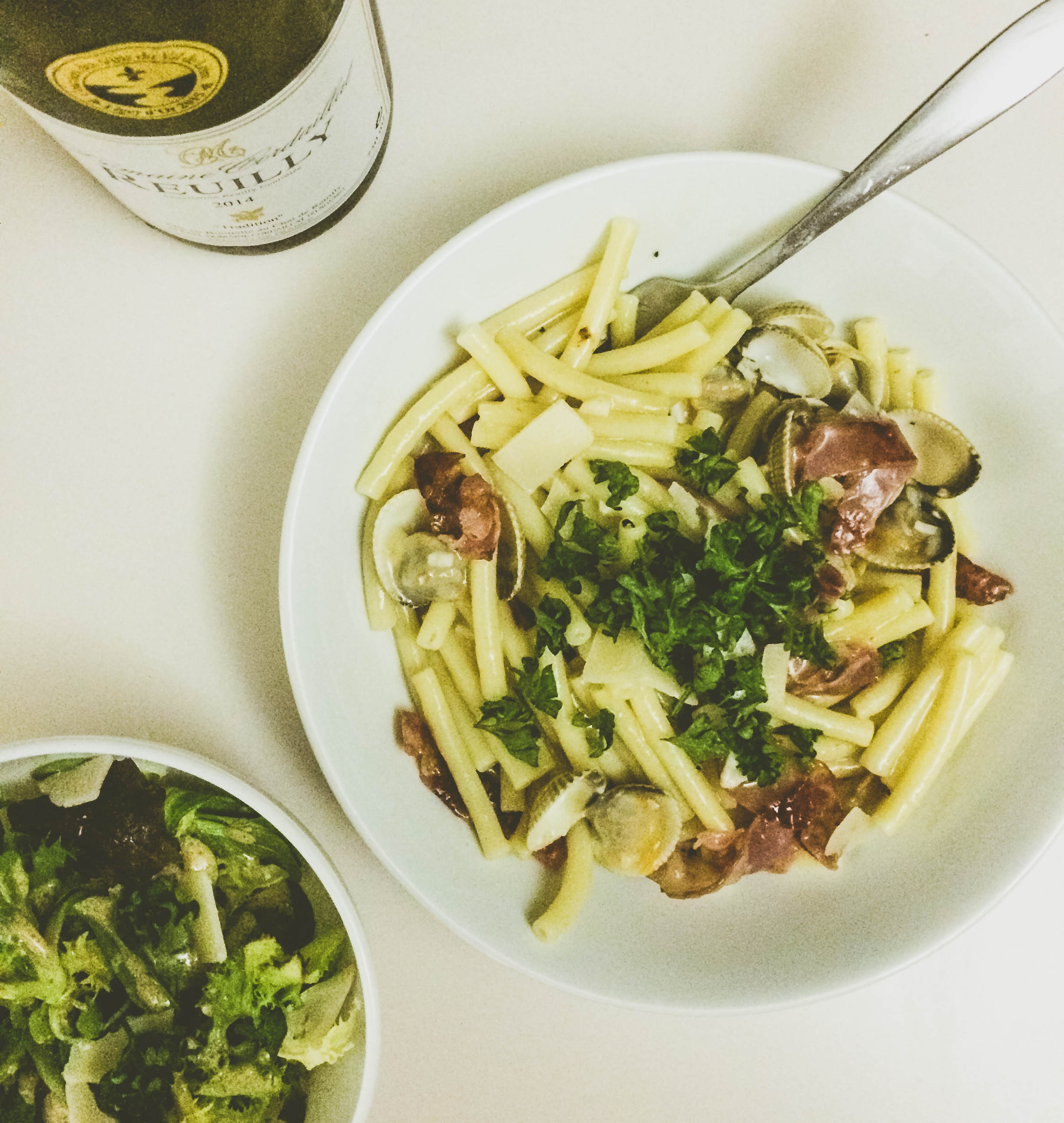 Finished pasta with cockles, pancetta and parsley, a green salad and crisp white wine.
