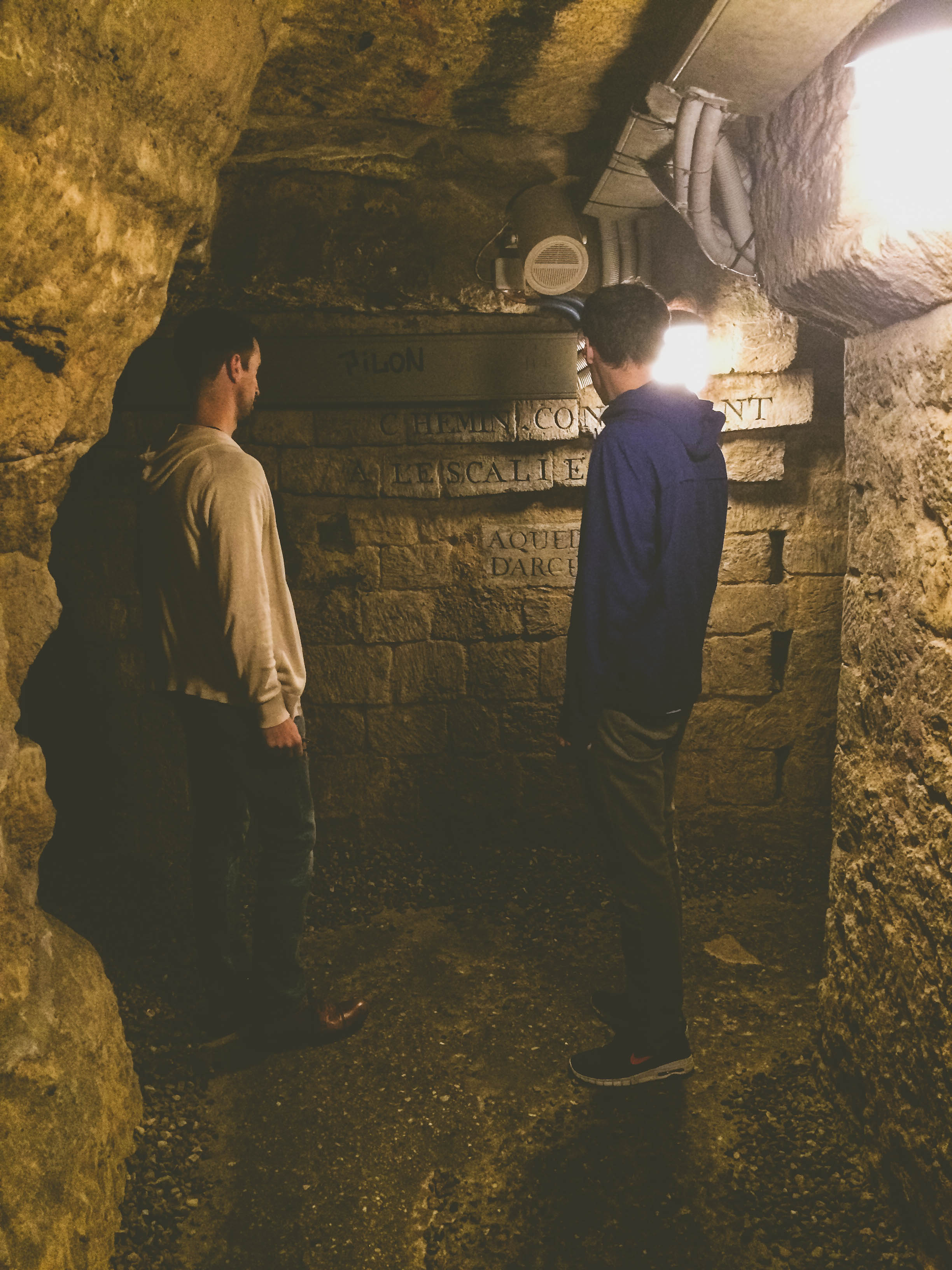 Steve and Chris reading about the history of the catacombs.