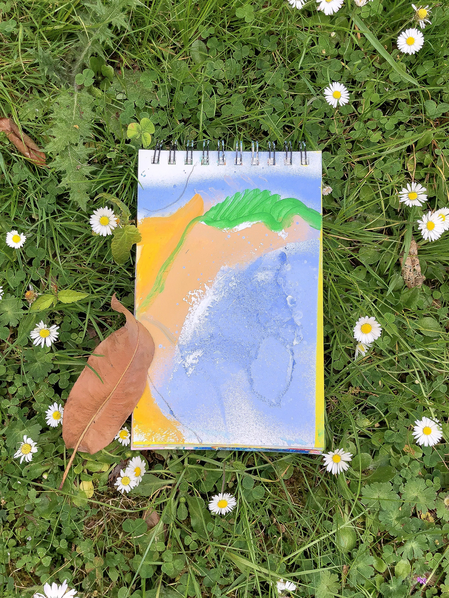sketchbook_on_the_grass.jpg