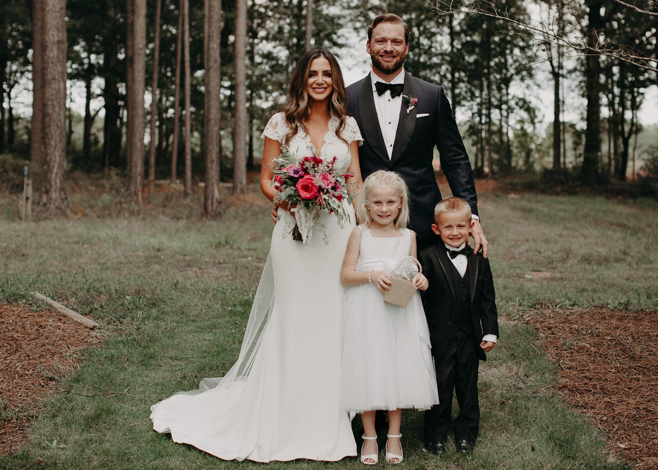 74 - Bride and Groom with flower girl and ring berear wedding serenbi farms atlanta .jpg