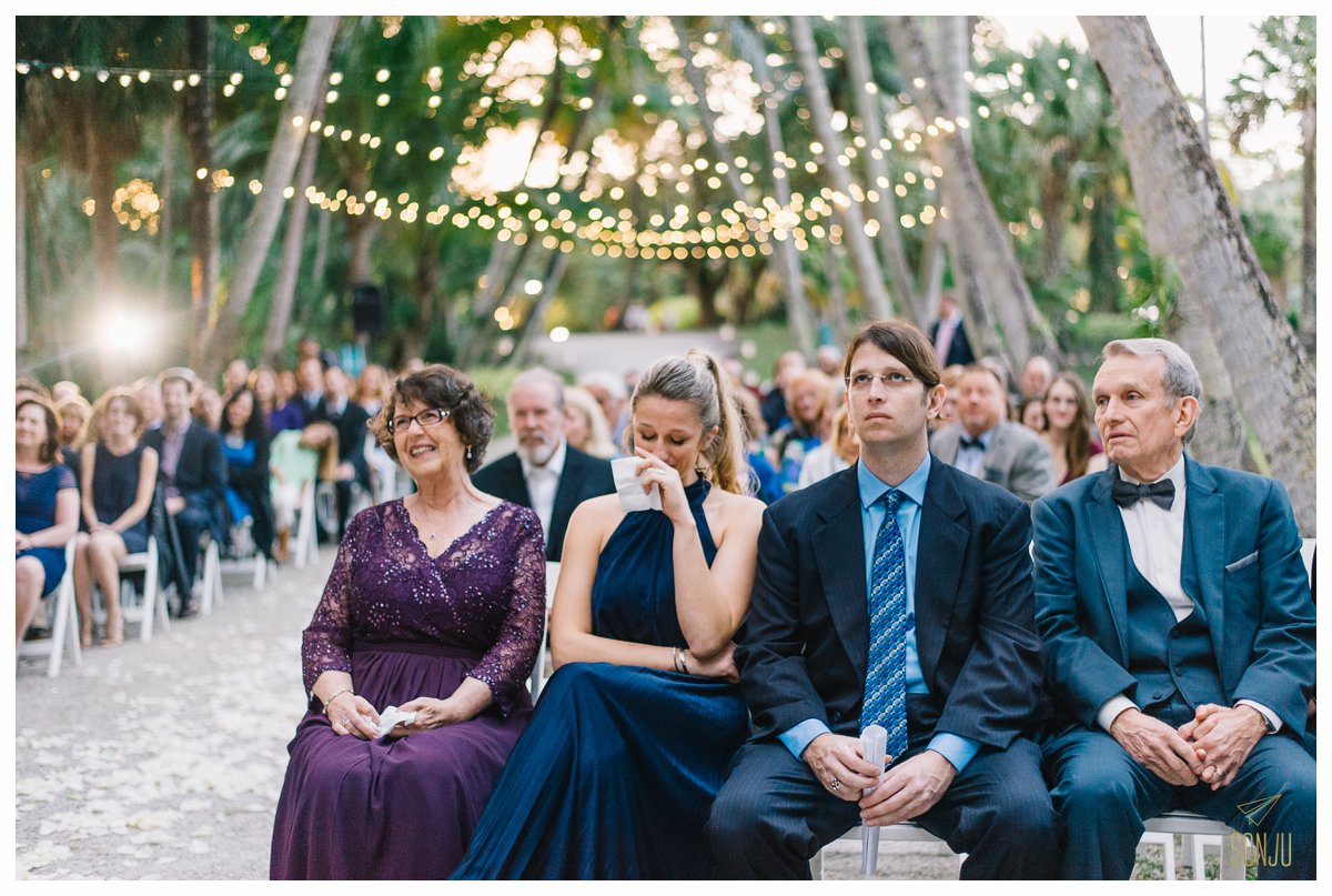Guests get emotional during a wedding ceremony at the Bonnet House in Fort Lauderdale Florida