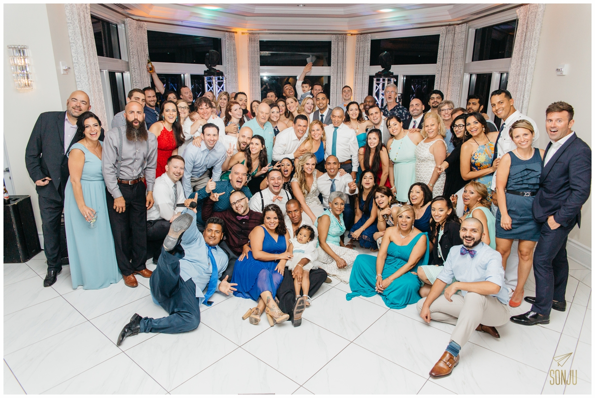 group shot at end of reception at the Pelican Grand Resort Fort Lauderdale Florida