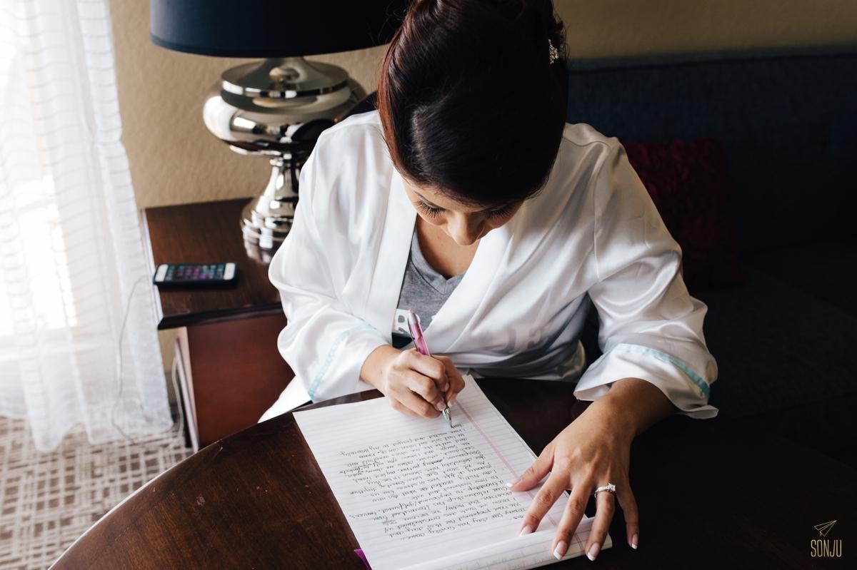Bride writes love letter at plantation renaissance hotel marriott