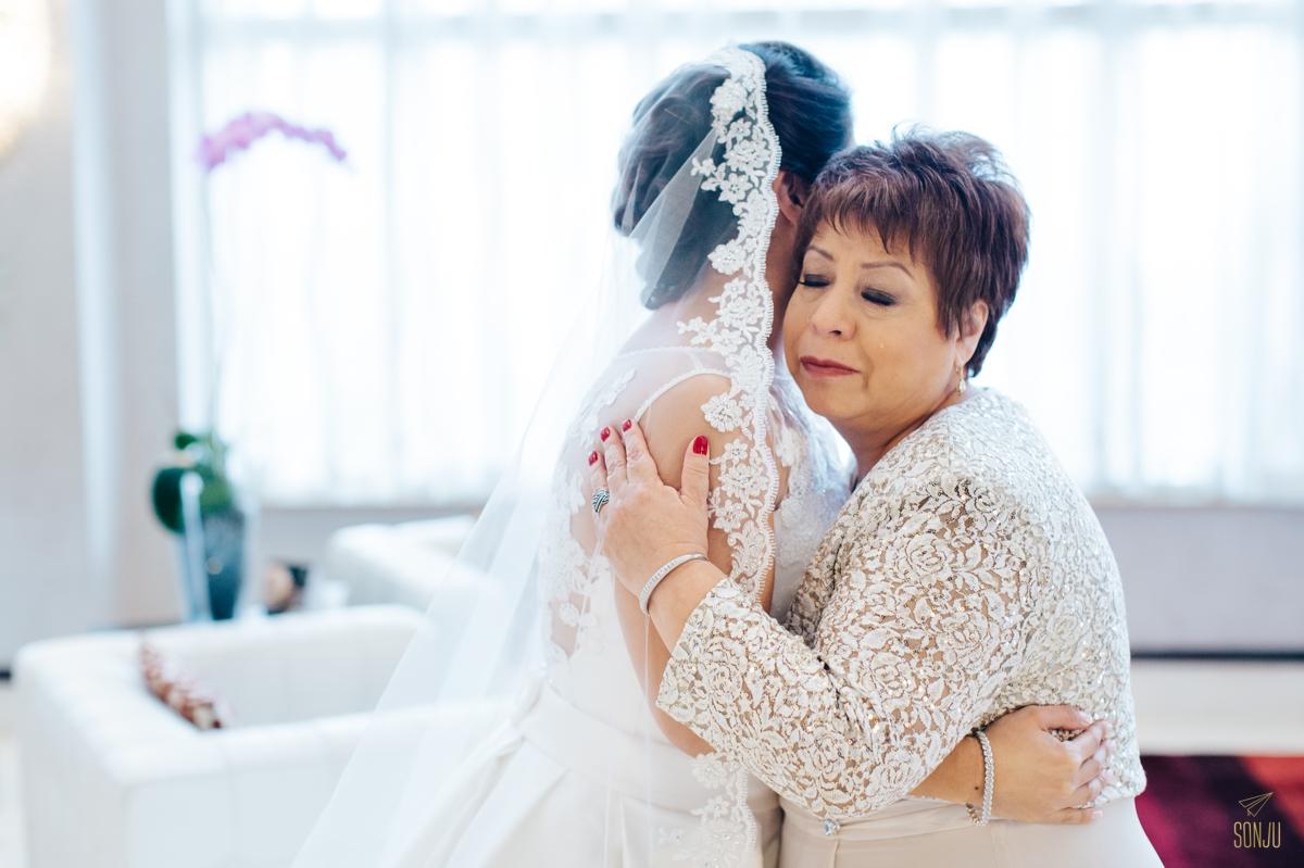 Mom and bride cry in lobby at Plantation Renaissance Hotel