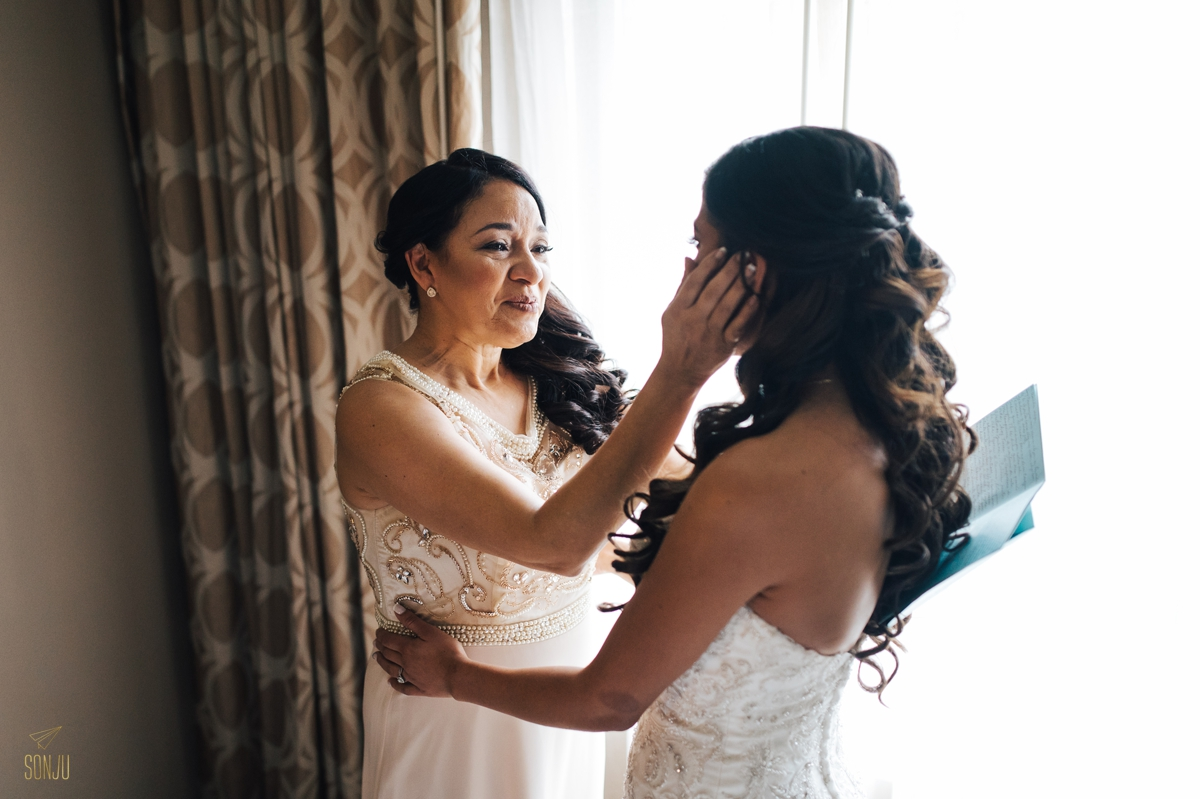 Mom wipes tear from brides face