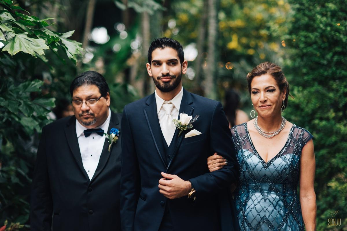 Parents walk groom down the aisle