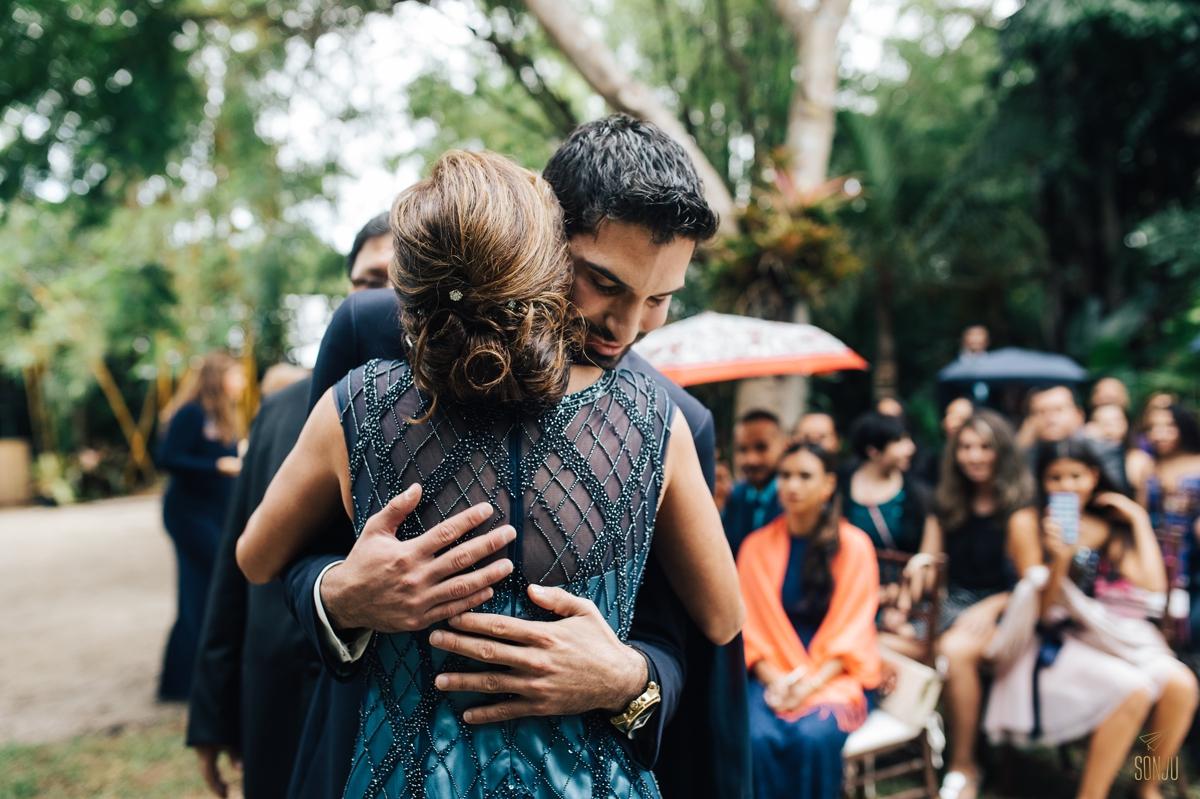 Mom hugs groom at ceremony