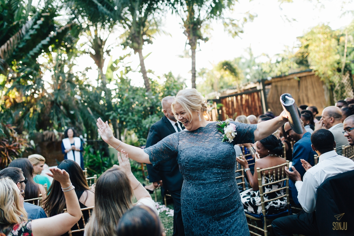 Mom high fives guests down the aisle