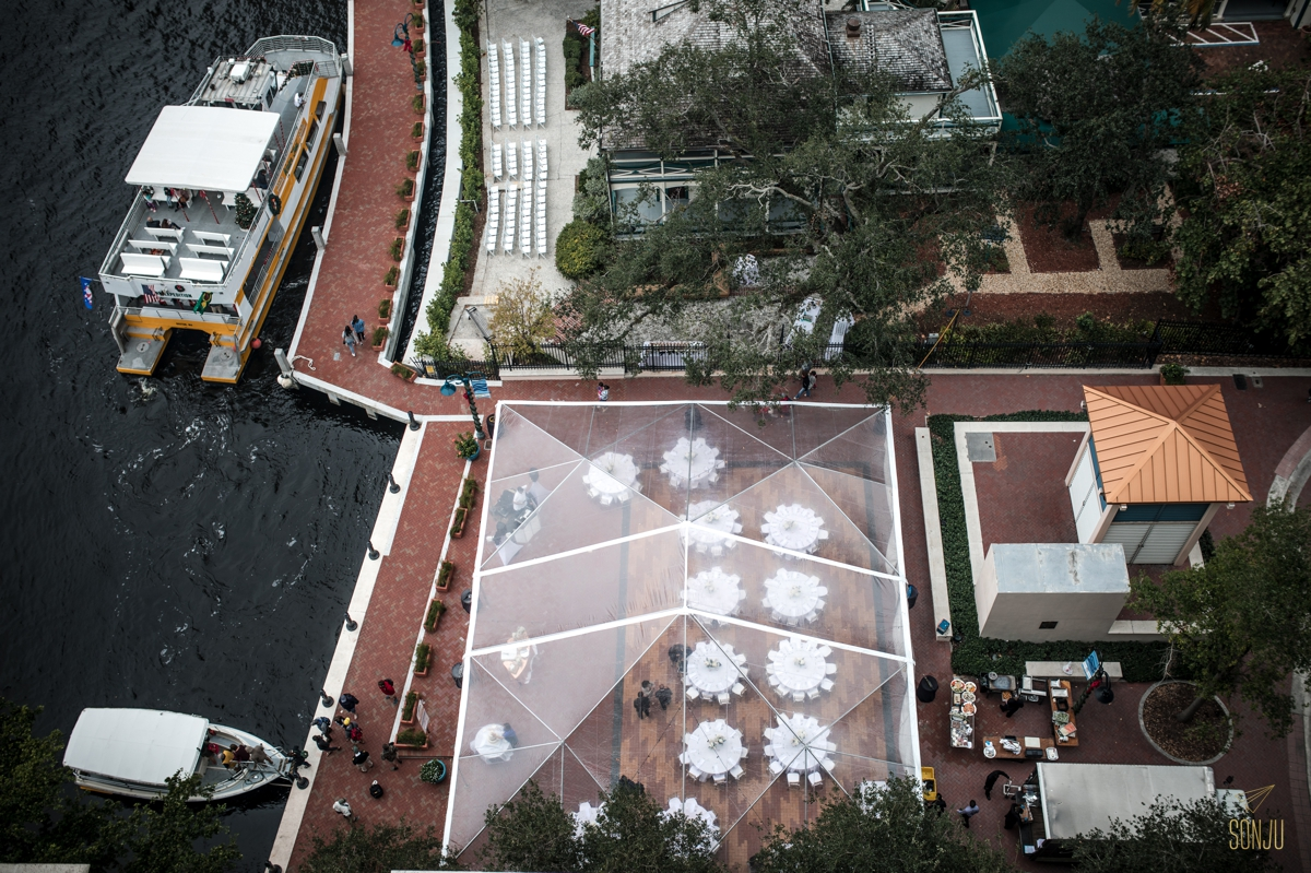 Aerial view of the Stranahan House in Fort Lauderdale Florida. Outdoor reception on the water under a clear tent.