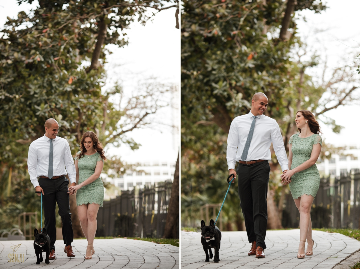 Bride and Groom to-be walk with their Frenchie in a park in Brickell Miami